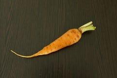 Zanahoria en fondo de madera Imagen de archivo
