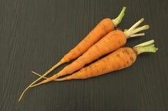 Zanahoria en fondo de madera Foto de archivo libre de regalías