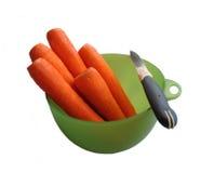 Zanahoria y cuchillo Imagen de archivo libre de regalías