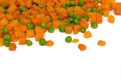 Zanahoria y guisantes verdes imagenes de archivo