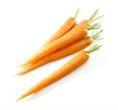 Zanahorias aisladas en blanco imágenes de archivo libres de regalías