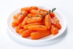 Zanahorias de bebé esmaltadas miel Fotos de archivo