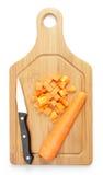 Zanahorias de corte en cuadritos Foto de archivo libre de regalías