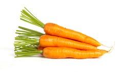 Zanahorias en el fondo blanco Foto de archivo libre de regalías