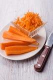 Zanahorias en la placa Foto de archivo libre de regalías