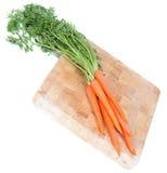 Zanahorias en tarjeta de madera Fotografía de archivo libre de regalías