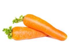 Zanahorias en un fondo blanco de la tela Imagenes de archivo