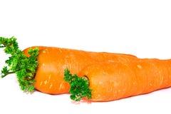 Zanahorias en un fondo blanco de la tela Fotografía de archivo