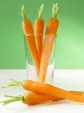 Zanahorias en vidrio imagenes de archivo