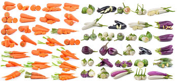 Zanahorias frescas y berenjena aisladas en el fondo blanco Fotos de archivo
