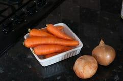 Zanahorias y cebollas Foto de archivo libre de regalías