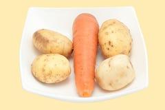 Zanahorias y patata Imágenes de archivo libres de regalías
