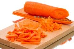 Zanahorias y rallador rallados Fotografía de archivo libre de regalías