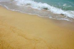 Zand en de Achtergrond van Golven Stock Foto's
