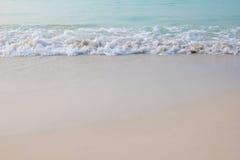 Zand en golf royalty-vrije stock afbeeldingen
