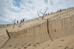 Zand en mensen in motie Royalty-vrije Stock Foto's