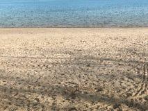 Zand en water Stock Afbeelding