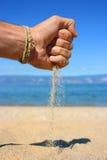 Zand-hand hand-zand Stock Foto