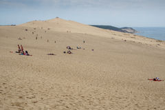 Zand, mensen en water Royalty-vrije Stock Fotografie