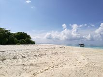 Zand, overzees en hemel Stock Afbeelding