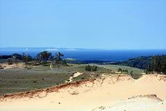 Zandduin met meer Stock Foto