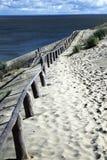Zandduinen en weg Stock Foto