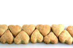 Zandkoeken in vorm van een hart stock afbeelding