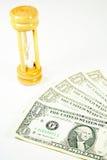 Zandloper en dollar Stock Afbeeldingen