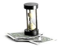 Zandloper en geld Stock Afbeeldingen