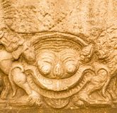Zandsteen het snijden in Prasat Hin Phimai stock fotografie