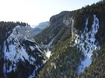 Zanoaga gorges in winter , Bucegi Mountains ,Romania, aerial view. Spectacular canyon of Zanoaga gorges in Bucegi mountains , Romania , aerial winter scenery stock photo