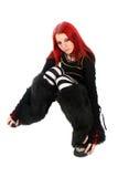 Zanudzająca czerwona włosiana dziewczyna na podłoga. Obrazy Royalty Free