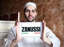Zanussi company logo. Logo of Zanussi company on samsung tablet holded by arab muslim man. Zanussi is an Italian producer of home appliances that was bought by royalty free stock images