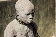 Zanzíbar, ciudad de piedra Criados ojerosos del monumento Fotos de archivo
