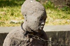 Zanzíbar, ciudad de piedra Criados ojerosos del monumento Fotografía de archivo libre de regalías