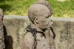 Zanzíbar, ciudad de piedra Criados ojerosos del monumento Foto de archivo