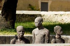 Zanzíbar, ciudad de piedra Criados ojerosos del monumento Fotos de archivo libres de regalías
