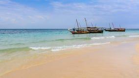 Zanzibar beach fishermen boat Stock Photo