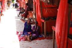 Zanzibar beach Maasai women sitting on the sand royalty free stock photography