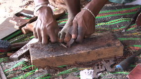 Zanzibar carpenter. Making tourist souvenirs stock video