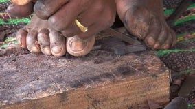 Zanzibar carpenter. Making tourist souvenirs stock video footage
