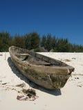 Zanzibar fishing boat. An old fishing boat on a beach in Zanzibar, Africa Stock Images