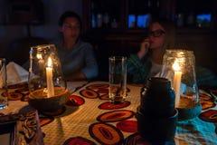 ZANZIBAR ISLAND, TANZANIA - CIRCA JANUARY 2015: Two girls inside Rock restaurant. ZANZIBAR ISLAND, TANZANIA - CIRCA JANUARY 2015: Table and two girls dining at Stock Photos