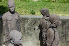 Zanzibar, Kamienny miasteczko Pomnikowi wychudli słudzy Zdjęcia Royalty Free