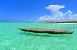Zanzibar Mnarani Nungwi beach boat. Zanzibar Mnarani shoreline, with turquoise water Stock Photos