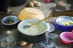 Zanzibar. Native woman cook the food in a village of the interland Stock Photo