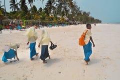 Zanzibar schoolchildren on the beach after school. Zanzibar, Kiwengwa - 19 January 2015: a group of teenage boys and girls running happily along the beach of Royalty Free Stock Photography