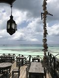 A Charming Patio above the Beautiful Waters of Zanzibar Stock Image