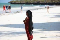 Zanzibar Tanzania, little Muslim girl on the beach stock photos