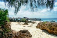 Zanzibar - Tropics - Prison Island beach, rock and sea. Zanzibar - Sea, beach, rock and nautical vessel at Prison Island - Indian Ocean royalty free stock photos